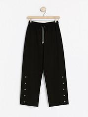 Černé žerzejové kalhoty Černá