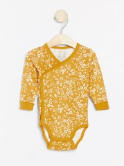 Floral patterned wrap bodysuit with long sleeves Yellow