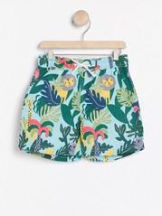 Vzorované plavecké šortky Tyrkysová