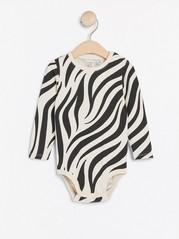 Långärmad body med zebramönster Beige