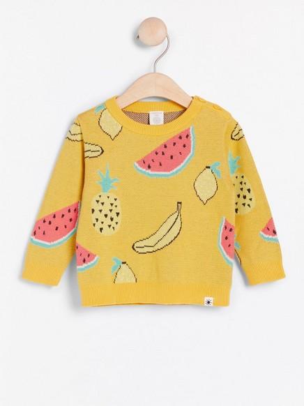 Keltainen neulepusero, jossa hedelmiä Keltainen