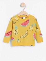 Gul stickad tröja med frukter Gul