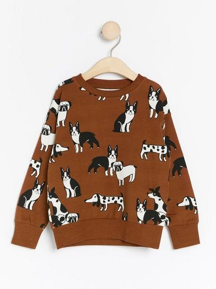 Overdimensjonert brun genser med hunder Brun