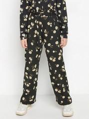 Leveälahkeiset housut, joissa kukkapainatus ja paperipussivyötärö Musta
