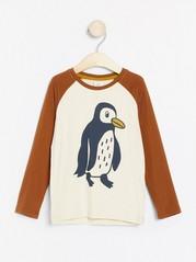 Raglantopp med pingvintryck Beige