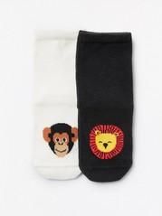 2 paria sukkia, joissa leijonat ja apinat Musta