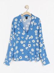 Blå bluse med blomstertrykk Blå