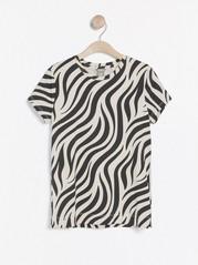 Topp med zebramönster Svart