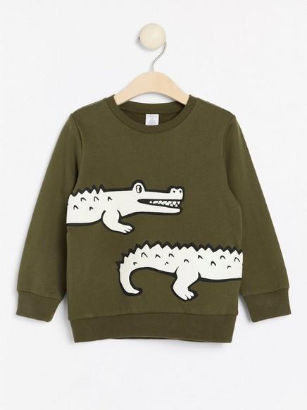 Tummanvihreä collegepusero, jossa kohokuvioitu krokotiili Vihreä