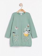 Ljusgrön tunika med kanintryck och fickor Grön