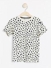 Oversize vit t-shirt med svarta prickar Beige