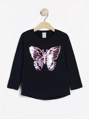 Langermet overdel med sommerfugl i vendbare paljetter Blå