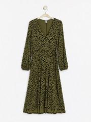 Lång klänning med omlottöverdel Grön