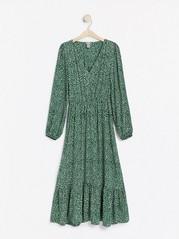 Mönstrad v-ringad klänning Grön