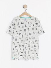 T-shirt med heltäckande mönster Vit