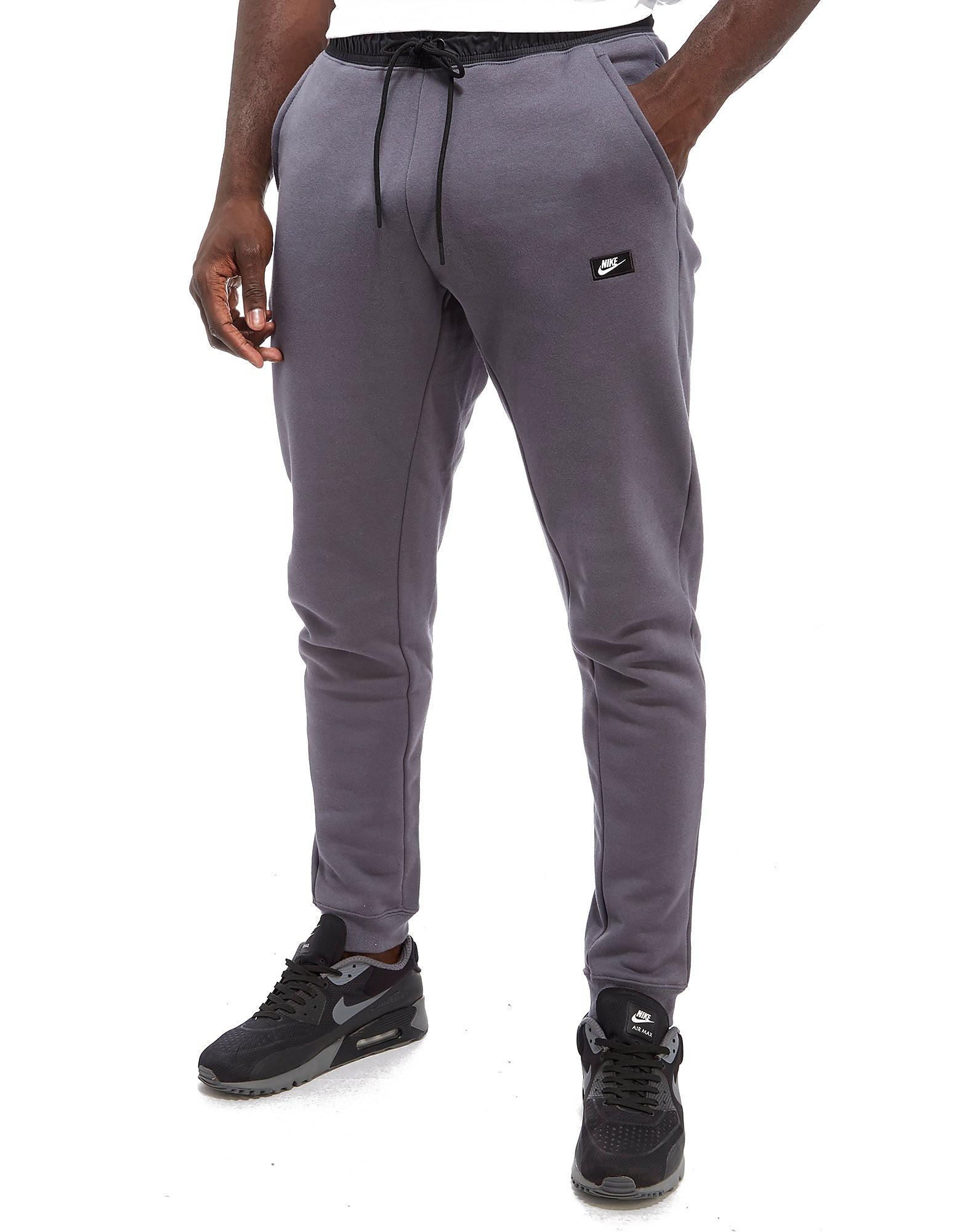 Nike Pantalon en polaire Modern