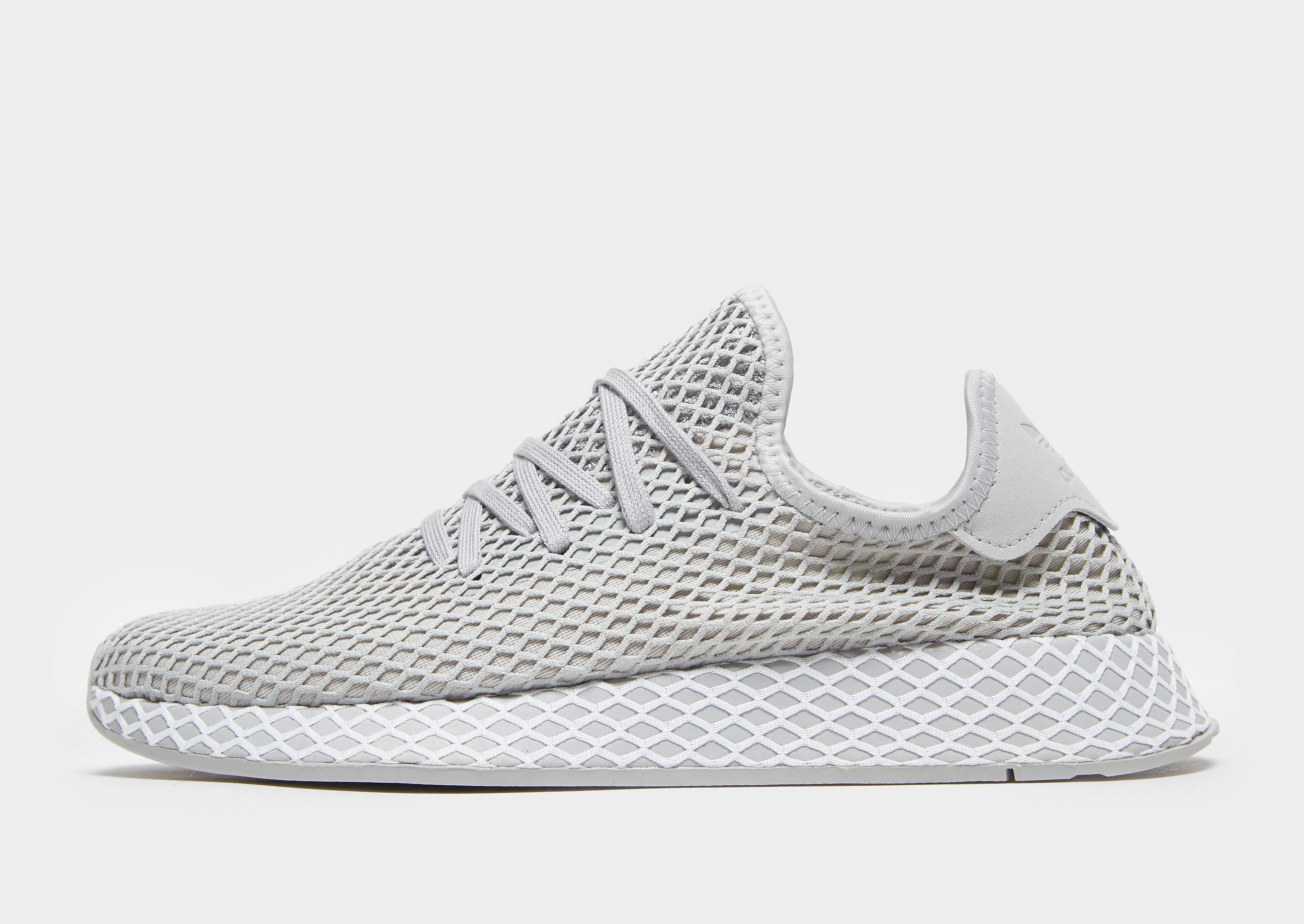 Adidas Deerupt herensneaker grijs en geel