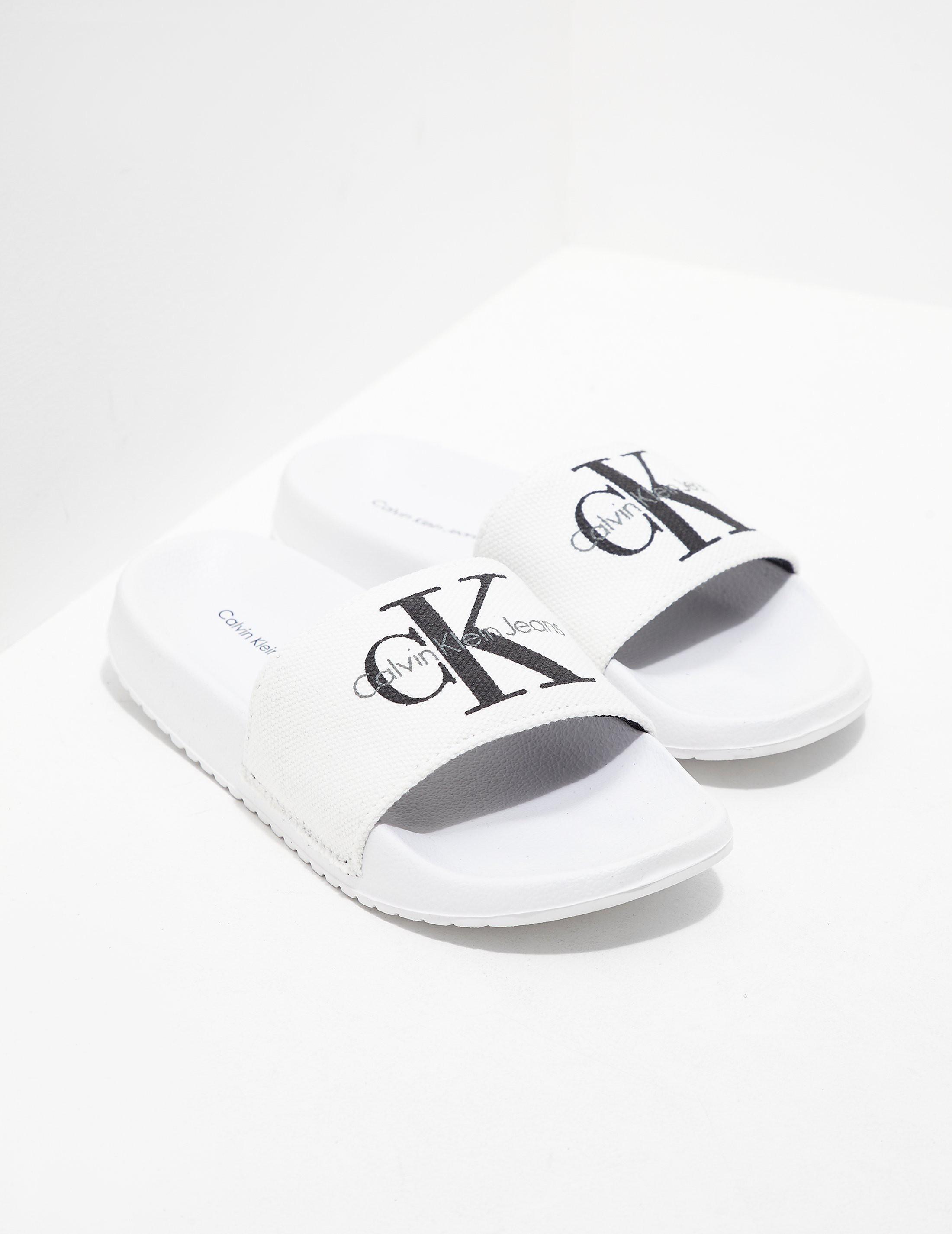 0590ca05f32a0e Womens Calvin Klein Jeans Chantal Slides Women s White