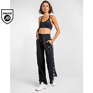 online retailer e8f1f 3169e NIKE Tape Popper Track Pants