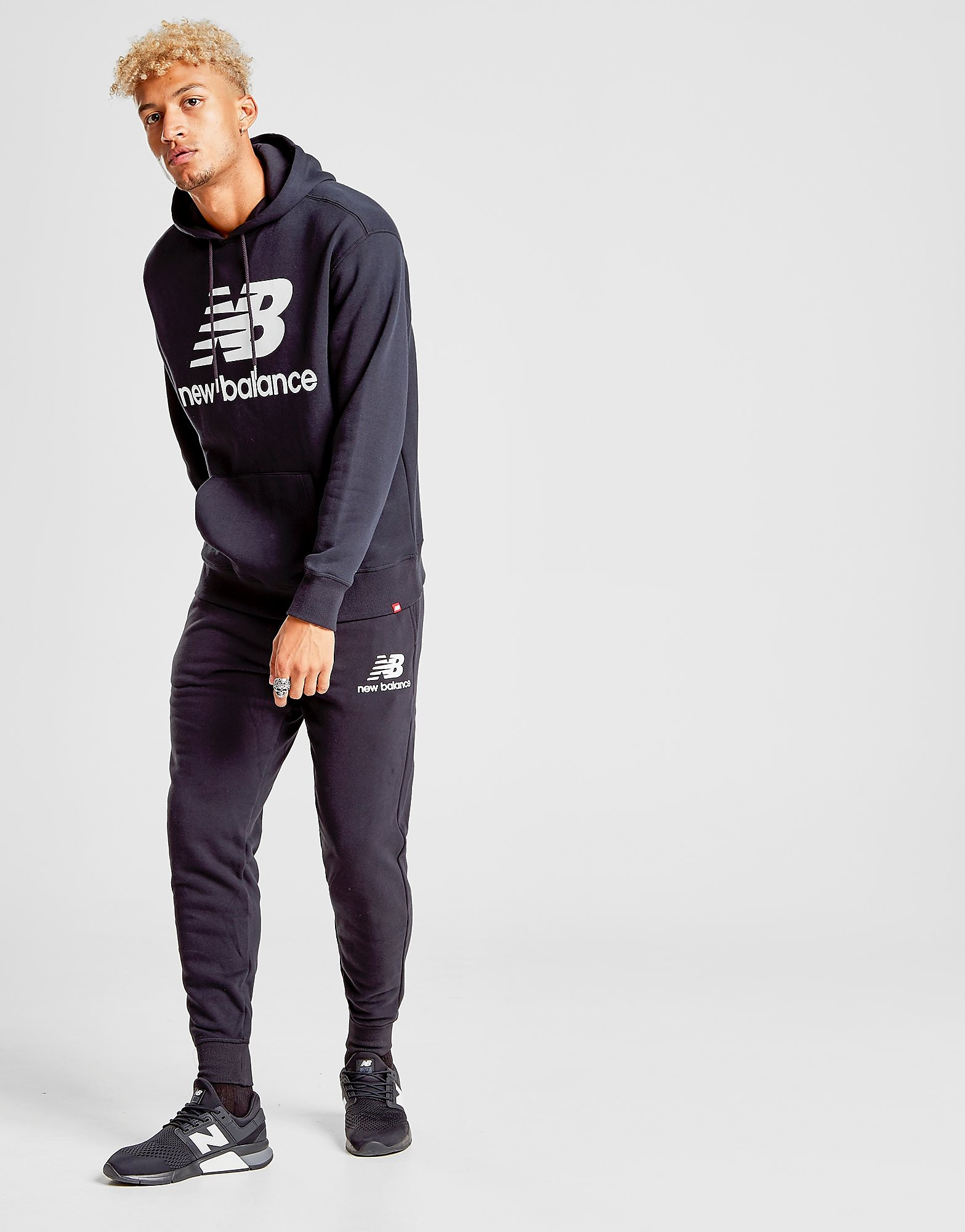 New Balance pantalón de chándal Logo